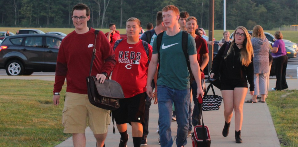 students walking into the school building
