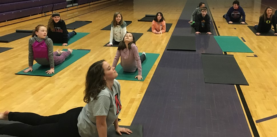 Students practicing yoga during Eagle Time