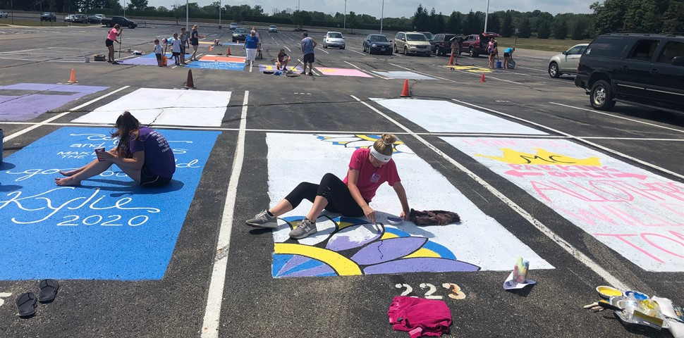 STUDENTS PAINTING THEIR HS PARKING SPOT