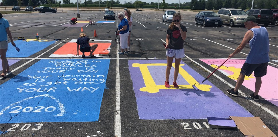 STUDENTS WITH THEIR PARKING SPOT DECORATIONS